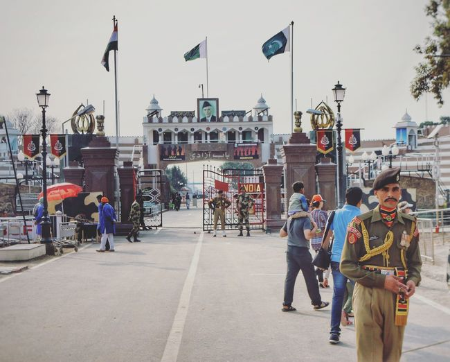 The Portraitist - 2017 EyeEm Awards Patriotism Flag Adult People Politics And Government Outdoors Real People Border Potrait Army Soldier Army India Indiansoldiers Realism Politics Wagahborder Wagah Boder Lahore Soldier Indiapakistanborder Live For The Story