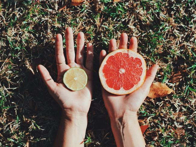 Fruit Person Human Body Part SLICE Food And Drink Healthy Eating Freshness Food Citrus Fruit Two People High Angle View Holding Real People Outdoors Grass Leisure Activity Day Blood Orange People Eye4photography  Pomegranate Lemon Red Blood Orange Food And Drink