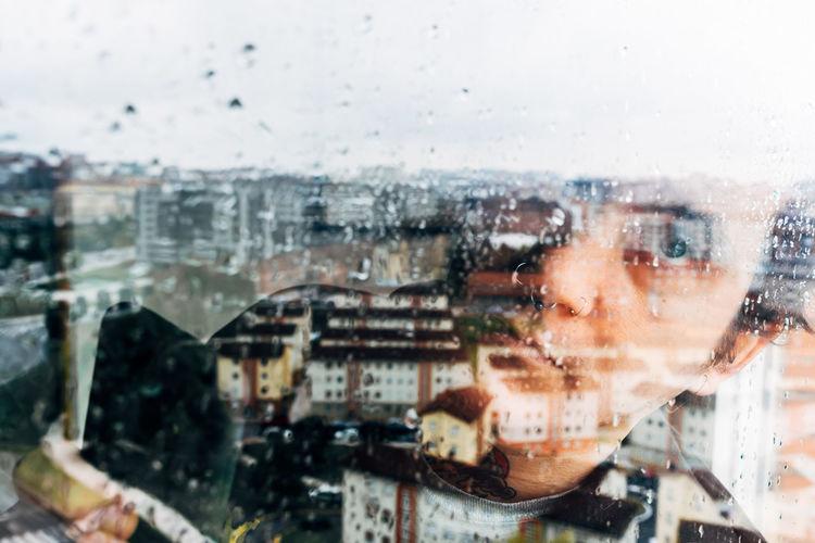 Portrait of city seen through glass window