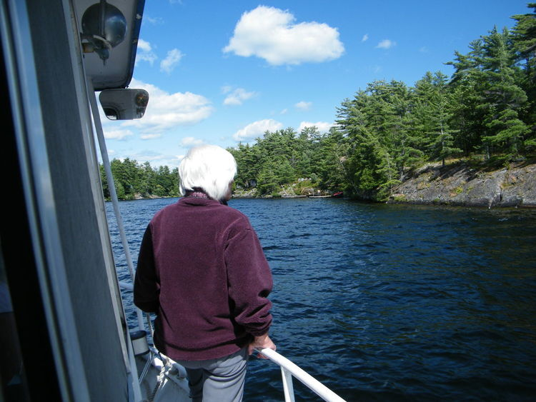 Just Cruising Perfect Day For Photgraphy Beauty In Nature Cloud - Sky Leisure Activity Lifestyles Nautical Vessel Observing Nature Rear View Senior Adult Standing