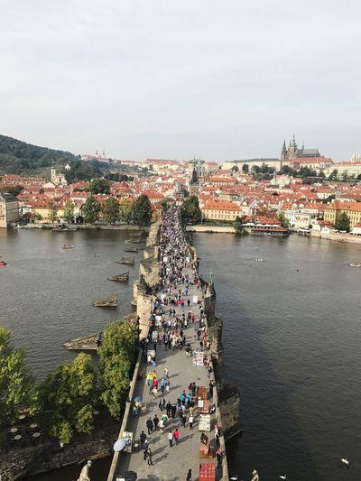 High angle view of people walking on charles bridge
