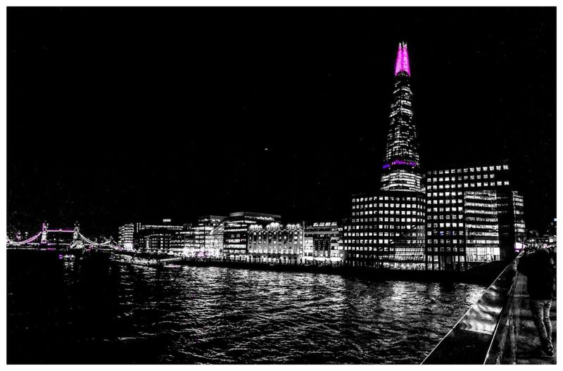 All of the lights Coloursplash Blackandwhite Bnw England United Kingdom Uk London Mobilephotography ShotOnIphone IPhone IPhoneography Night Architecture Built Structure Illuminated Building Exterior Travel Destinations Tower Travel Sky City Tourism Outdoors Water
