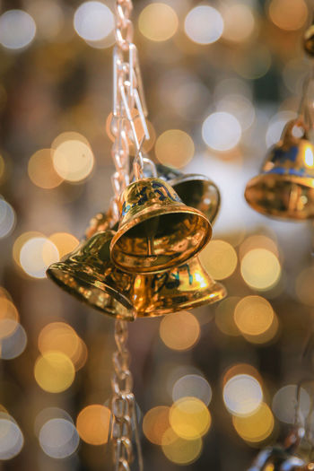 Gold bell Bell Bokeh Bokeh Background Bokeh Bubbles Bokeh Lights Bokeh Photography Bokehphotography Celebration Christmas Christmas Decoration Close-up Design Focus On Foreground Freckless Gold Colored Illuminated Indoors  Lens Flare Lighting Equipment No People Selective Focus Still Life