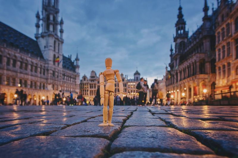 In the very heart of Brussels Architecture Town Square Outdoors Illuminated Old Town Focus On Foreground Creativity Woodyforest Belgium Brussels Human Representation Dusk Travel Destinations