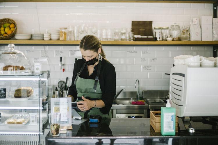 Full length of woman standing in restaurant