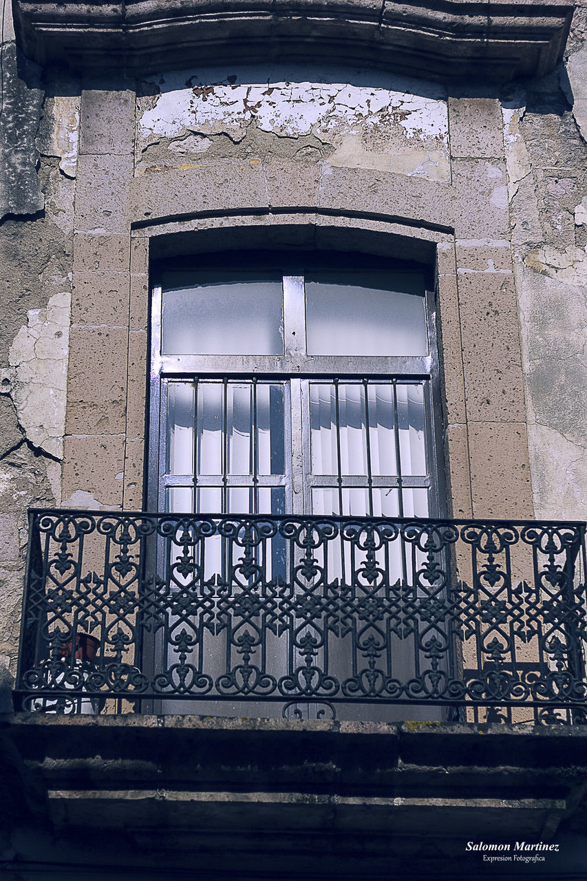 architecture, built structure, window, low angle view, building, building exterior, day, no people, glass - material, old, outdoors, railing, security, metal, protection, safety, pattern, reflection, wall - building feature, closed, wrought iron, ornate