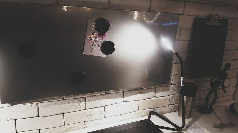 Light falling on blackboard in office