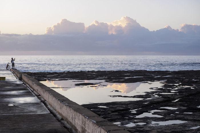 Coastline Cyclist Horizon Over Water Morning Lights Ocean Reflection Rockpool Sea Tranquility