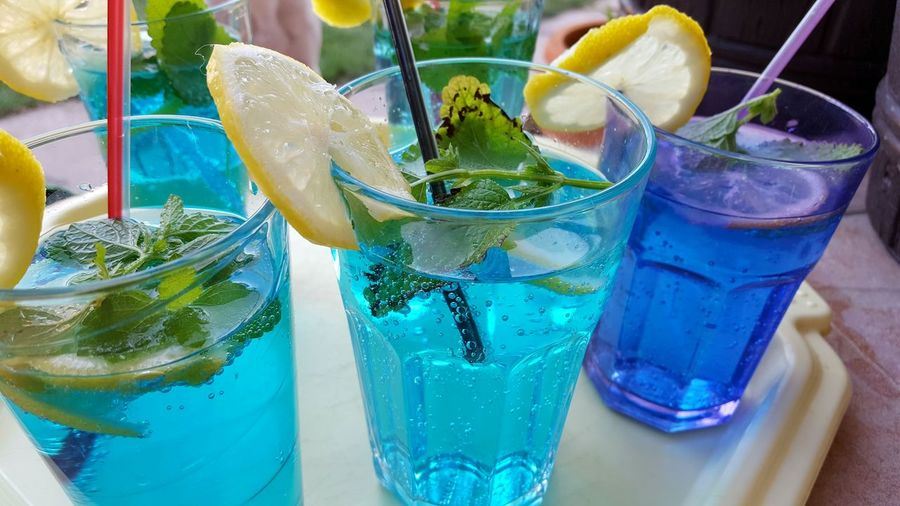 Summer coctails Coctails Summer Memories 🌄 Drinks Lemon On The Glass Coctail_party Summer Feeling Garden Party Color Photography Glasses EyeEm Best Shots Eyeem Hungary Summertime The Facebook Cover Challenge Eye4photography  Close-up Koktel Pohár Curacao Blue Coctails Blue Curaçao Showcase June People Together