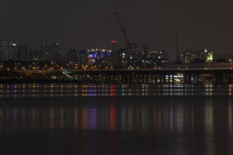 Illuminated bridge over han river against sky at night
