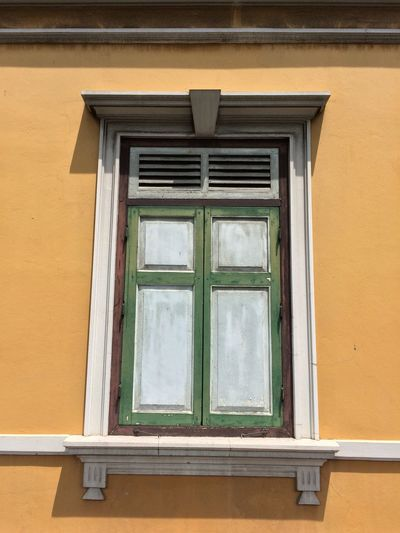 Window Built Structure Architecture Building Exterior Building No People Day Glass - Material Wall - Building Feature House Low Angle View Outdoors Residential District Green Color Window Frame Wood - Material Wall Yellow