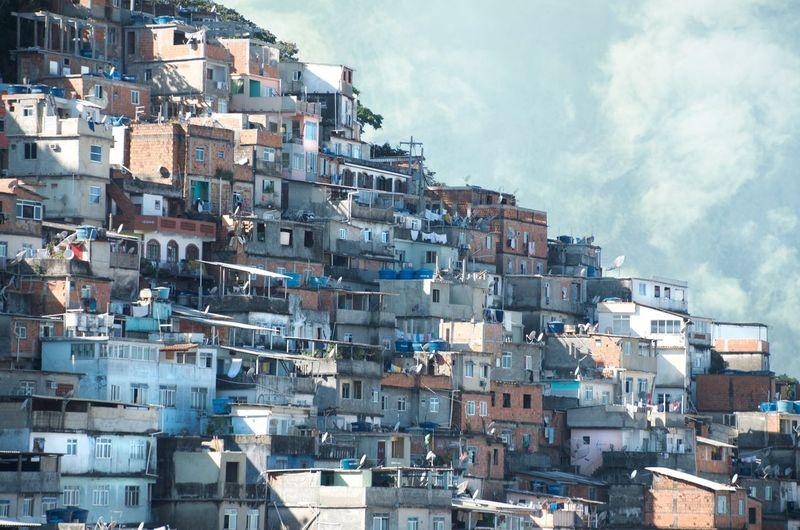 Rio Rio De Janeiro Favelabrazil Favela Building Exterior Architecture Built Structure City Residential District Building Crowded Cityscape Crowd Day Sky Cloud - Sky Outdoors City Life Community House Town TOWNSCAPE Blue Blue Sky