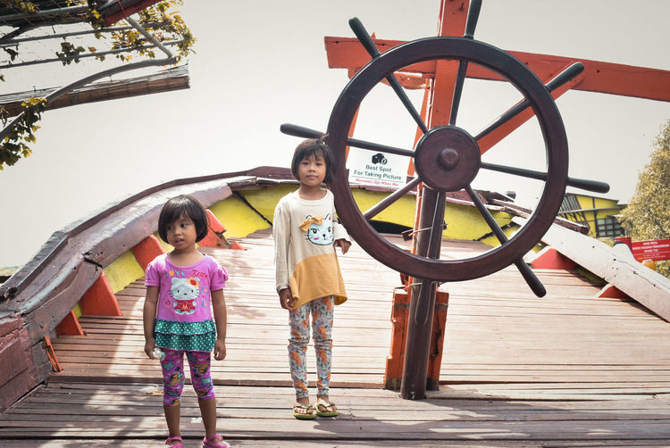 Child Childhood Offspring Females Girls Women Two People Full Length People Water Togetherness Family Nature Day Transportation Wheel Adult Standing Sister Outdoors