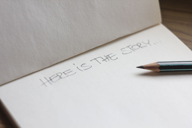 Here is the story... Storytelling Beginning Close-up Communication Copy Space Handwriting  High Angle View Indoors  Message No People Notebook One Paper Pencil Still Life Story Table Text Western Script Writing Writing Instrument