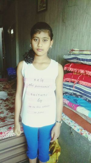 ग्व fh Three Quarter Length Childhood Girls Elementary Age Casual Clothing Front View Standing Three Quarter Length Lifestyles Leisure Activity Text Person T-shirt Looking At Camera Person Long Hair Innocence Day First Eyeem Photo