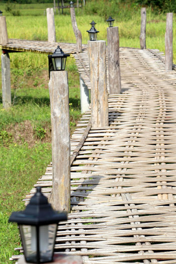 Wooden bridge made of bamboo and lamp Surrounded by nature in Thailand. Lamp Bridge Post Wooden Post Wooden Bridge Bamboo Bamboo Bridge Natrue Floor Wooden Floor Bamboo Floor Rural Paddy Field Health Thailand Healthcare Lifestyle People Lifestyle Summer Holiday Recreation  Relax Tree Wood - Material Wooden Post Protection Grass Wooden Boardwalk Wood