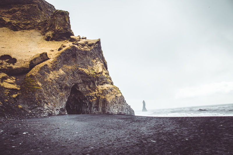 Days of travel: 7 - Reynisdrangar Sea Rock Water Rock - Object Sky Beauty In Nature Solid Tranquility Nature Rock Formation Day Scenics - Nature Land Beach Tranquil Scene Horizon Over Water Horizon No People Cliff Outdoors Eroded Iceland Iceland_collection Landscape_Collection Landscape