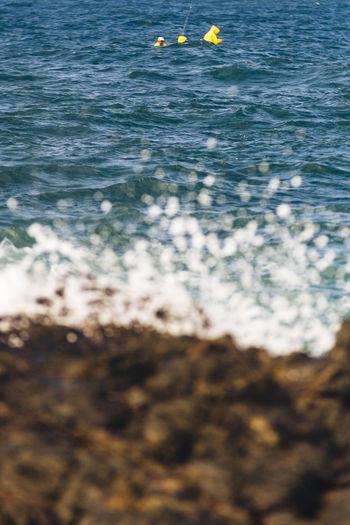 Beauty In Nature Day Fisherman Fishermen's Life Nature Sea Splash Splashing Water Waves And Rocks Waves Crashing Waves Crashing On Rocks Waves Splashing Yellow Raincoat