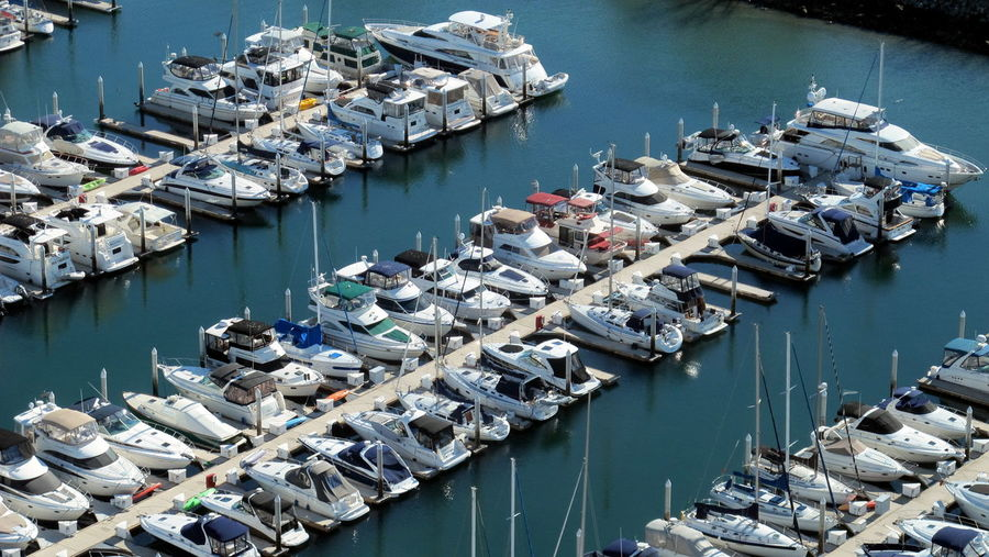 High Angle View Of Boats Moored At Harbor