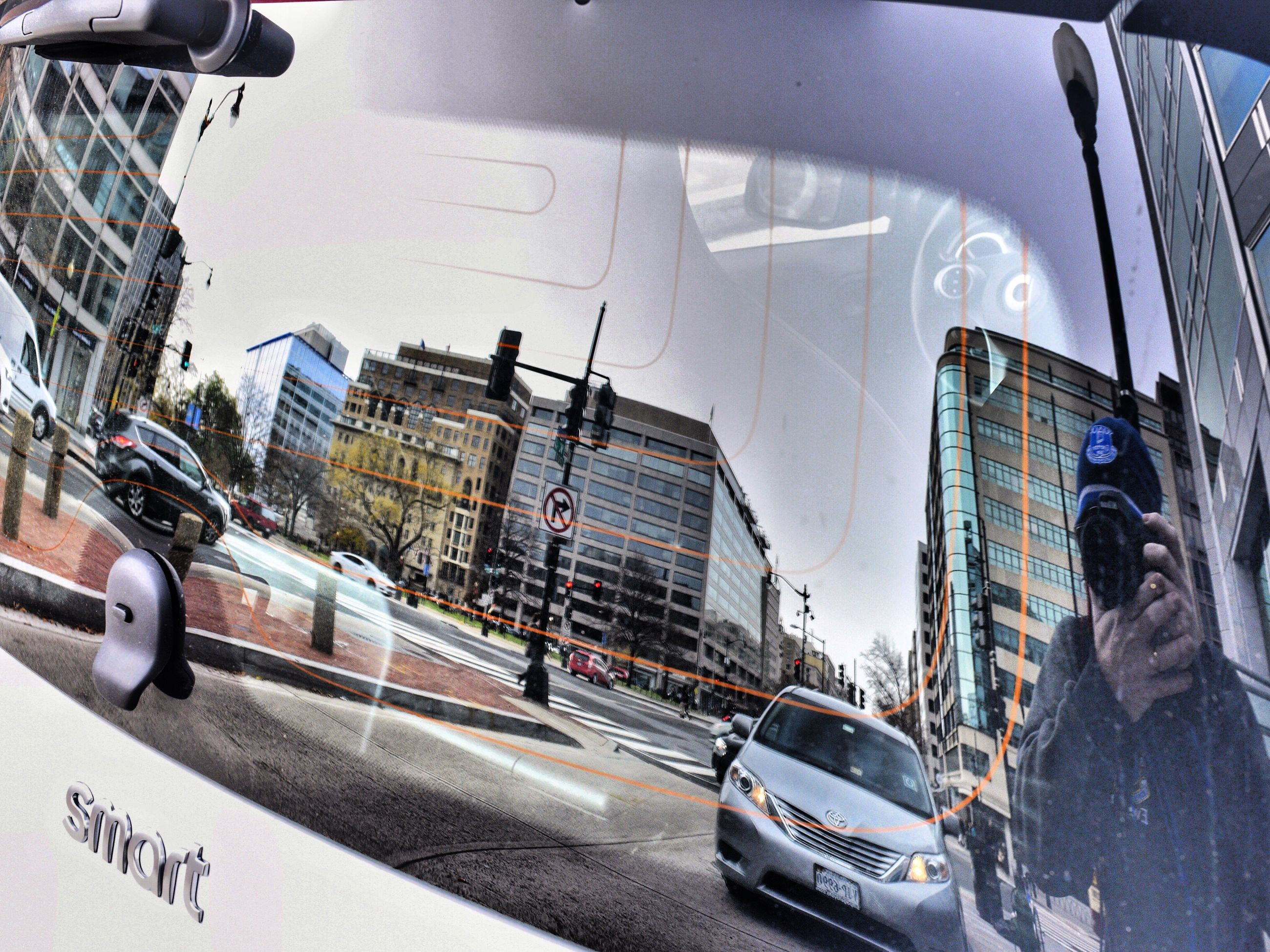 building exterior, built structure, architecture, city, street, transportation, car, land vehicle, road, outdoors, city life, day, sky, real people, men, one person, skyscraper, people