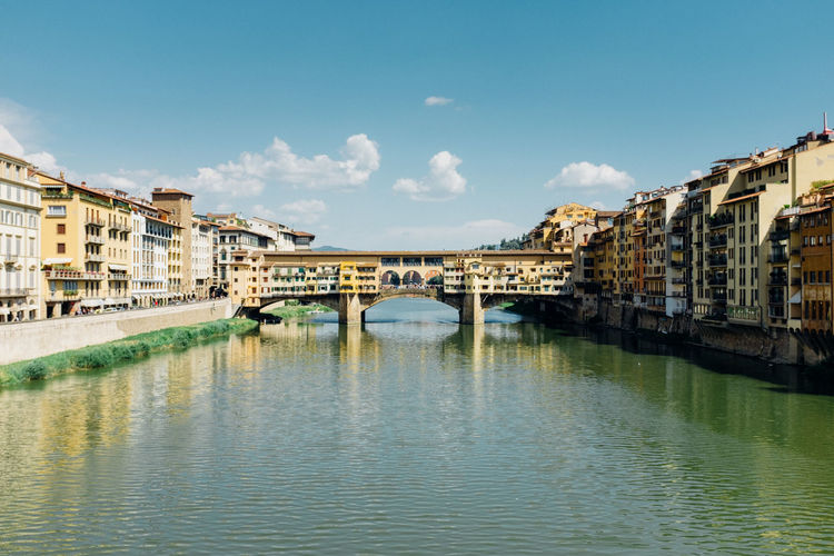 Ponte Vecchio Over Arno River In City Against Sky