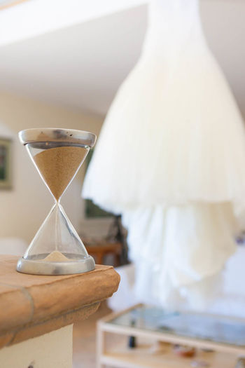 Close-Up Of Hourglass On Table At Home