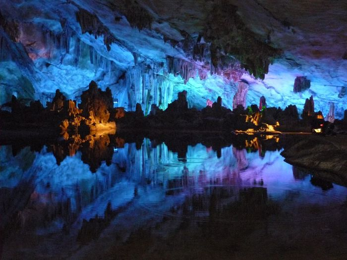 illuminated stalactite cave China Geology Rock Formation Physical Geography Stalactite  Blue Water Rings Reflections In The Water Water Stalactite Cave Stalacmite Colors Colorful Multi Colored Stalactites And Stalagmites Pattern, Texture, Shape And Form Patterns & Textures Backgrounds Full Frame Cave Caves Photography EyeEm Gallery EyeEm Selects Stalactite  Reflection Illuminated Lake Scenics Water Nature
