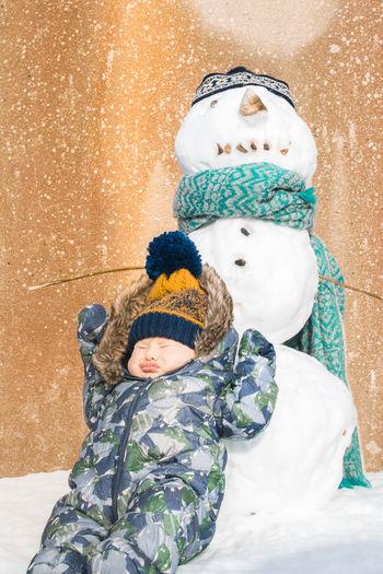 Full length of cute boy in snow