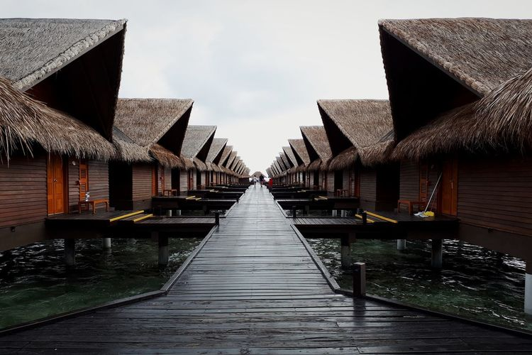 Maldives Hudhuranfushi Ocean Villas Wooden Walkway Thatched Roof Sea Seascape View Water Wood - Material Sky Architecture Building Exterior Built Structure Footbridge vanishing point Diminishing Perspective Pathway Pier The Architect - 2018 EyeEm Awards