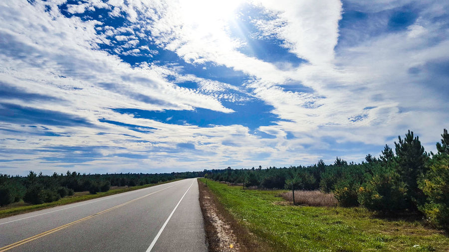 Grass Panoramic Fall Beauty Trees And Sky Trees And Nature Scenics - Nature Tree Road Blue Rural Scene Sky Landscape Cloud - Sky Empty Road vanishing point Asphalt The Way Forward Yellow Line Double Yellow Line White Line Country Road Diminishing Perspective Highway Treelined