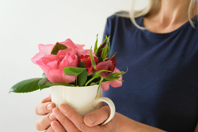Celebration Creativity Everyday Joy Freshness Holiday Small Business Woman Blossom Craft Cup Flower Fresh Front View Gift Giving Holding Lifestyles One Person Real People Rose - Flower Young Adult