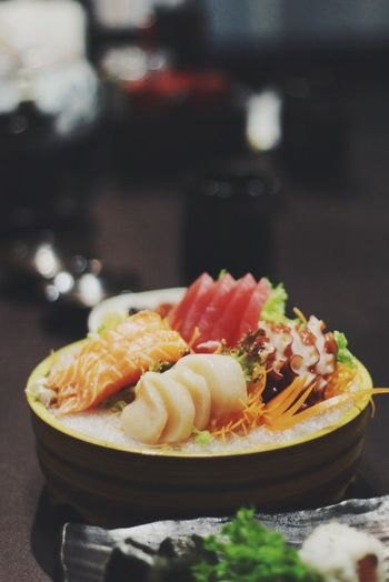 Close-up of sashimi served in bowl on table
