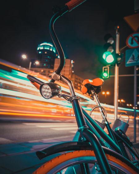 Close-up of bicycle at night