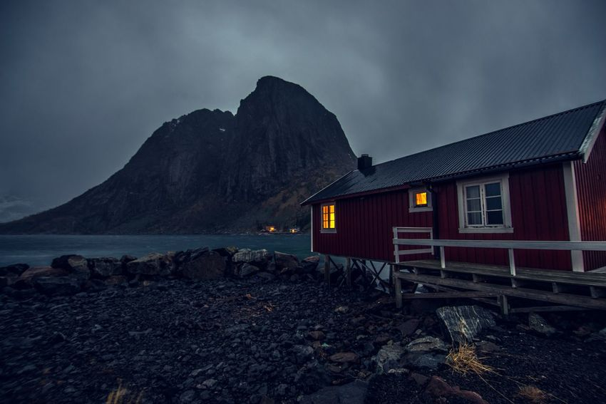 A cozy place to spend the cold Lofoten Islands Winter Architecture Beauty In Nature Dark Day Hamnøy Islands Light Lofoten Lofoten Islands Lofoten Norway Mood Mountain Mountain Range Nature No People Norway Outdoors Reine Rorbu Scenery Sky Snow Water Weather Winter Shades Of Winter The Great Outdoors - 2018 EyeEm Awards The Traveler - 2018 EyeEm Awards HUAWEI Photo Award: After Dark