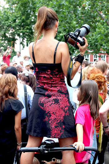 a photographer with her daughter at the carnival of cultures in Berlin, Germany Beauty Berlin Camera Carnival Crowd Crowded Street Cultures Daughter Fun Hair Karneval Der Kulturen Lifestyles Long Hair Mother Outdoors Photographer Photography Street Photography Young Women