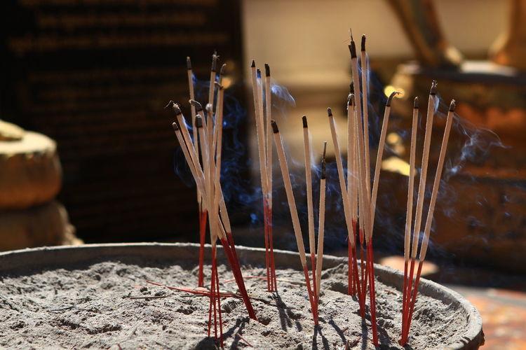 Incense Sticks Burning In Buddhist Temple