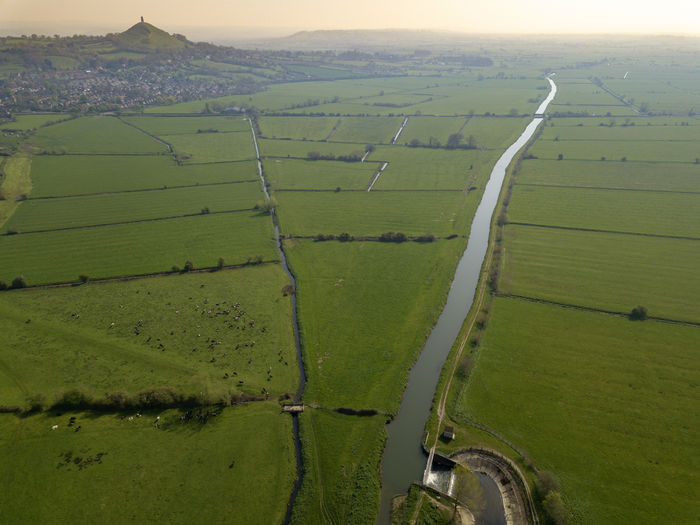 Glastonbury Tor and some of the surrounding farm land Landscape Environment Scenics - Nature Field Beauty In Nature Green Color Land Tranquil Scene Agriculture Rural Scene Tranquility Nature No People Day Idyllic Farm Non-urban Scene Growth Patchwork Landscape Aerial View Outdoors