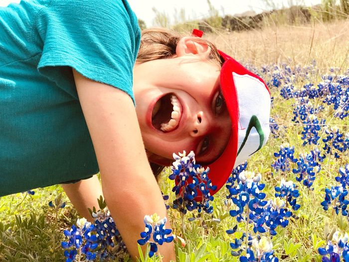 Outdoors Child Happy Hat Bluebonnets Fun Silly Field Happiness Real People Outdoors Childhood Day Smiling Boys Flower Portrait Cheerful Grass Nature Leisure Activity