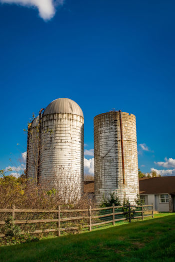 Farming and grain silos taken at the Norristown Farm Park.. Daytime Decay Farm Grass Nature Pennsylvania Tree Architecture Blue Blue Sky Building Building Exterior Built Structure Cylinderical Day Daylight Farmland Countryside Fence Green Nature Howard Roberts No People Outdoors Shrub Silo Sky
