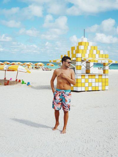 Miami, FL Beach Boy Man Mensfashion Miami Miami Beach Miami South Beach Sunrise Man Man Swimming Beach City Multi Colored Full Length Sea Sand Summer Men Fun Water Beach Holiday Beach Umbrella Beach Towel Sun Lounger Sunbathing Parasol Sun Hat Wave Swimming Trunks