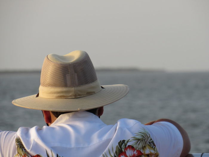 In The Zone Casual Clothing Close-up Day Focus On Foreground Hat Tranquil Scene Vacations Eyeem Collection At Getty Images Atmospheric Mood Travel Destinations Tourism Seascape leisure activity Lifestyles Man People And Places.