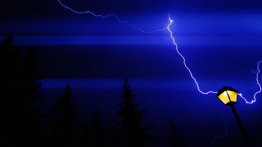 Stormy lightning strike Lightning Night Thunderstorm Power In Nature Storm Danger Illuminated Weather Storm Cloud Nature Scenics Beauty In Nature Outdoors Sky No People Freshness Clear Sky Nature Beauty In Nature Tranquility Landscape Blue