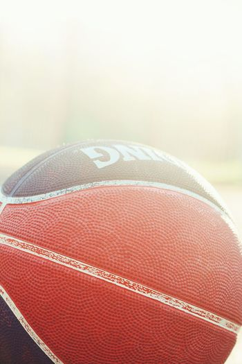Basketball Basketball Sport Ball Close-up American Football - Sport American Football - Ball Focus On Foreground No People Selective Focus Day Single Object Brown Textured  Leather Red Pattern Indoors  Still Life Basketball - Sport Copy Space
