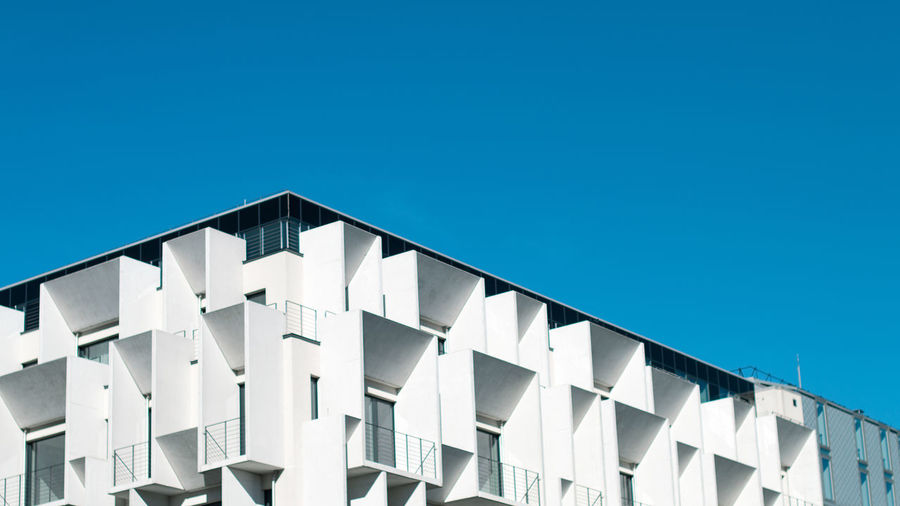 Architecture Built Structure Blue Building Exterior Sky Clear Sky No People Low Angle View Building Nature Day Copy Space Sunlight White Color Outdoors Modern In A Row Side By Side Repetition Pattern Apartment