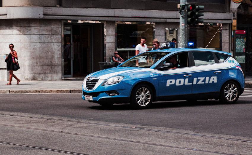 Car Emergency Vehicle Italian Police Car Land Vehicle Outdoors Police Car Police Force Police Uniform Real People Street Photography Transportation