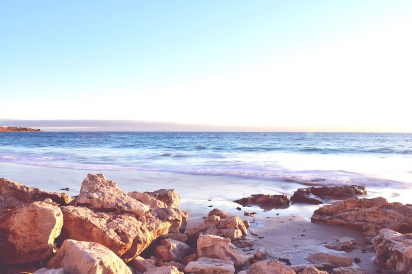 EyeEm Selects EyeEm Selects Sea Horizon Over Water Water Nature Beauty In Nature Scenics Tranquil Scene Rock - Object Beach Tranquility Idyllic Copy Space No People Outdoors Wave Sky Clear Sky Day Pebble Beach