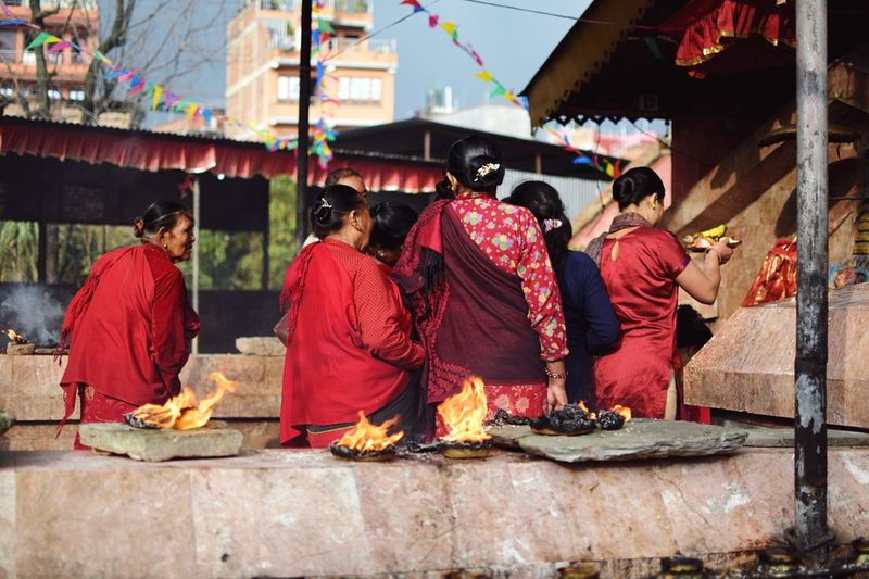 At the Temple. Fire Street Photography Temple Nepal Hinduism Group Of People Real People Religion Belief Clothing Adult Men Traditional Clothing Architecture Rear View Spirituality People Women Place Of Worship Medium Group Of People