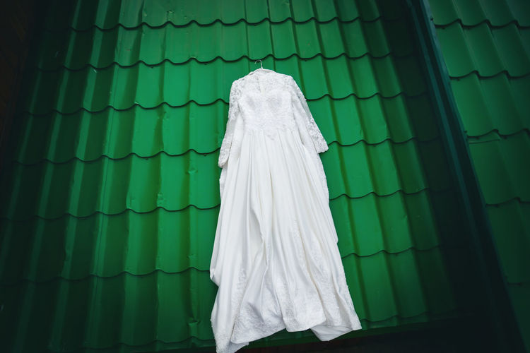 High anlge view of wedding dress on rooftop