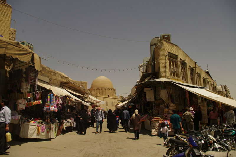 Market Adult Architecture Building Exterior Built Structure Clear Sky Day History Iran Isfahan Outdoors People Place Of Worship Real People Religion Sky Spirituality Suq Tourism Travel Travel Destinations Vacations