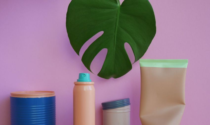 Beauty Products And Leaf Against Pink Background